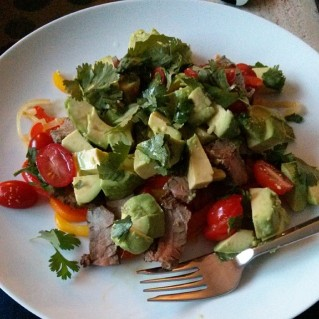 Carne Asada steak over sautéed peppers and onions, topped with avocado, lime juice and cilantro.